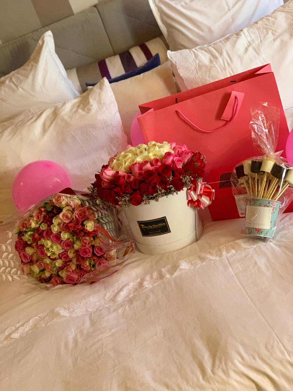 So there is a bunch of flowers for the birthday girl on the bed next to a cache of gifts lying close by..