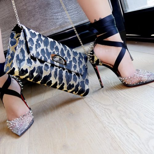 Shoe: Christian Louboutin Mechante Reine Pumps Clutch Bag: Vero Dodat in animal print by Chritian Louboutin