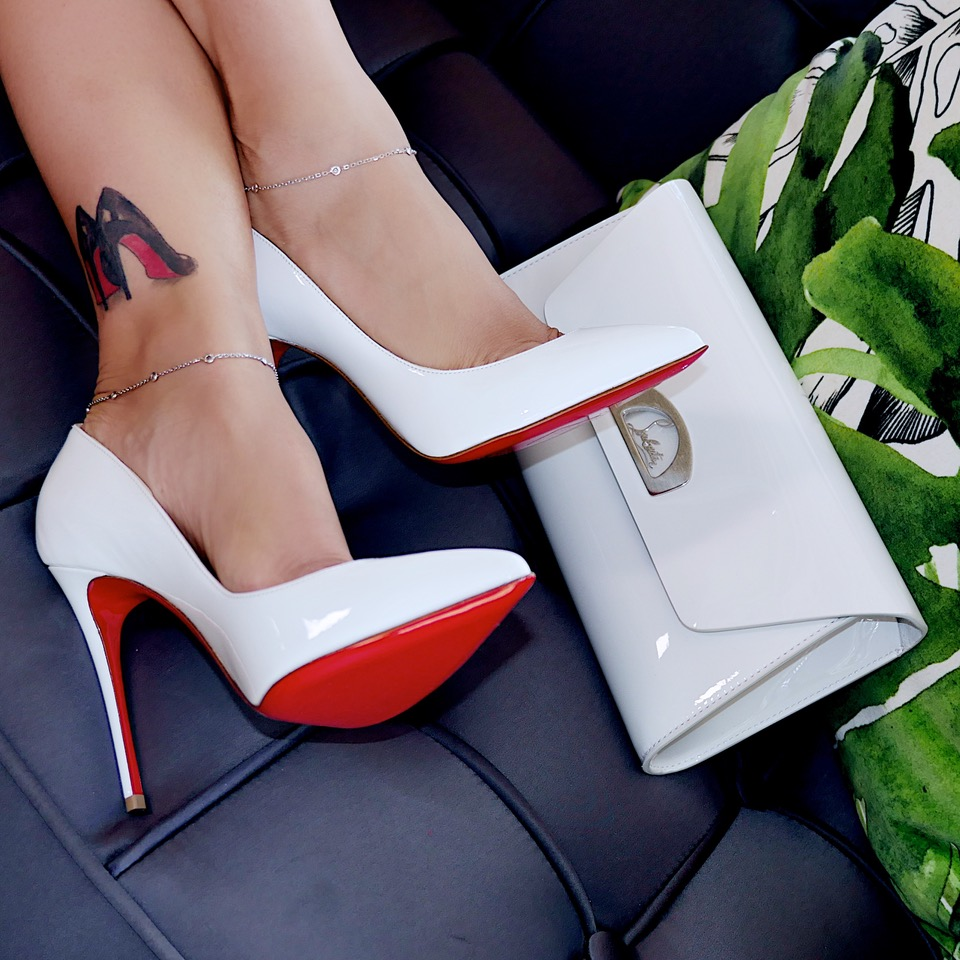 Shoe: Christian Louboutin follies in milk while. Clutch bag: Vero Dodat in milk white